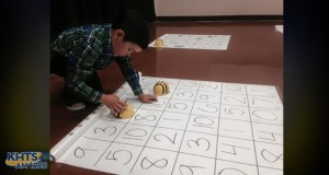 Kindergartner Tyler Do dashed around a 3-by-3 mat on the ground covered with numbers that made it look like a multiplication table at Mitchell Community Elementary School for the STEAM Expo.