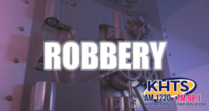 """Louie: Robbery slider_money safe in background, reads """"Robbery"""""""
